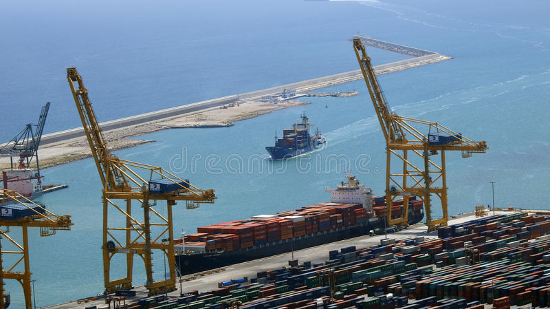 Ship arriving to an industrial port stock image