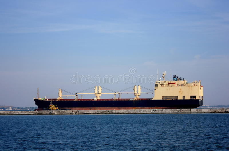 Ship arriving to port royalty free stock photos