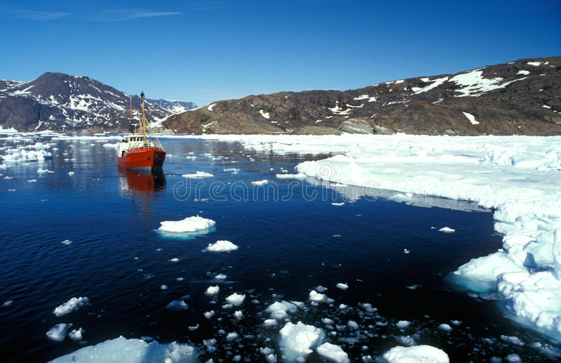 Ship in the artic sea by eastern Greenland. In Ammassalik stock image