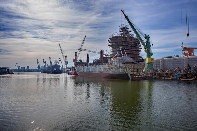Ship is being renovated in shipyard stock photography