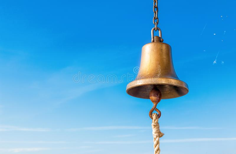 Ship bell against the sky stock photography