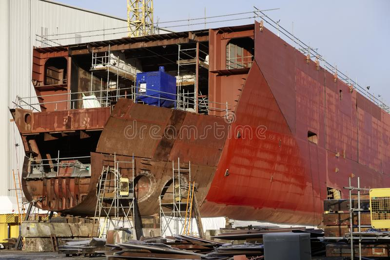 Ship building yard at shipbuilding construction dock with scaffolding in progress royalty free stock images