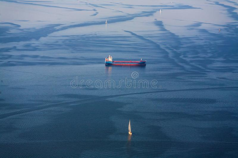 The ship bunker and sailing yachts go to sea. View from above. stock photos