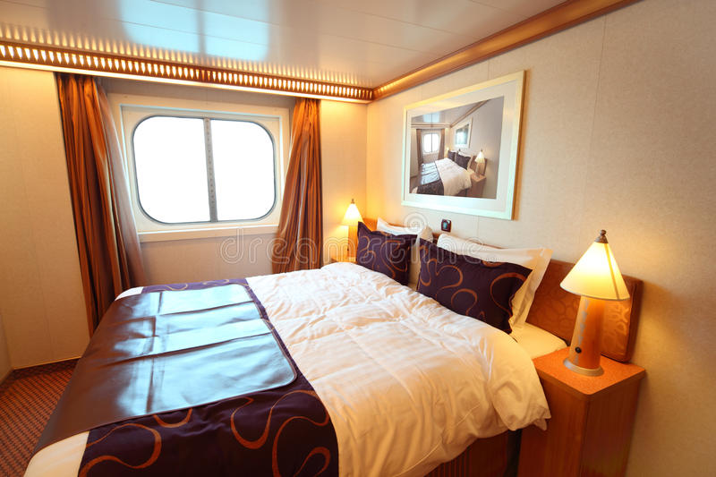 Ship cabin with bed and window. Ship cabin with big double bed and window summer day royalty free stock image