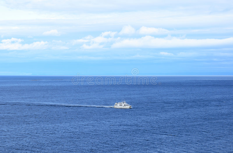 Download Ship in the calm blue sea stock image. Image of cloudy - 6313121