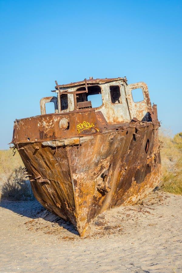 Ship cemetery, Aral Sea, Uzbekistan. Old ships in the desert `ship cemetery` the consequence of Aral sea disaster, Muynak, Uzbekistan stock image