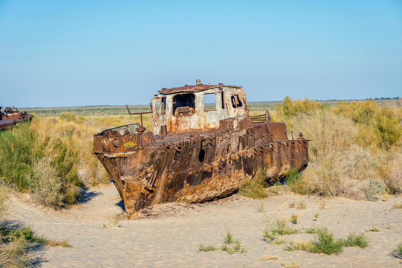 Ship cemetery, Aral Sea, Uzbekistan. Old ships in the desert `ship cemetery` the consequence of Aral sea disaster, Muynak, Uzbekistan royalty free stock photography