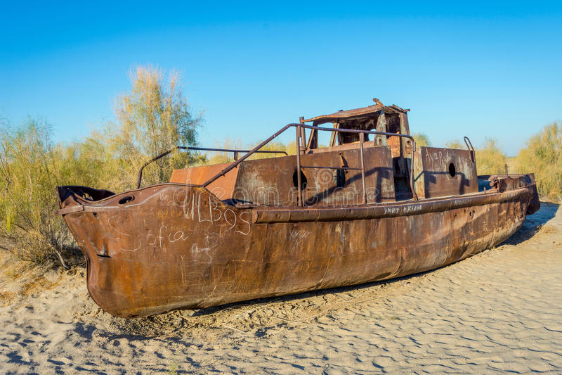 Ship cemetery, Aral Sea, Uzbekistan. Old ships in the desert `ship cemetery` the consequence of Aral sea disaster, Muynak, Uzbekistan royalty free stock photos