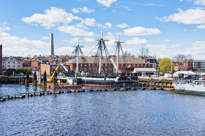 Ship at Charlestown peninsula in Boston MA. Ship at Charlestown peninsula and Bunher Hill Monument on the background in Boston, MA, the United States stock photos