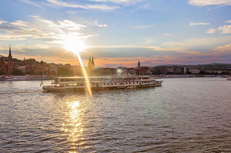 Ship on the Danube River in Budapest Hungary in the rays of the sun royalty free stock photo