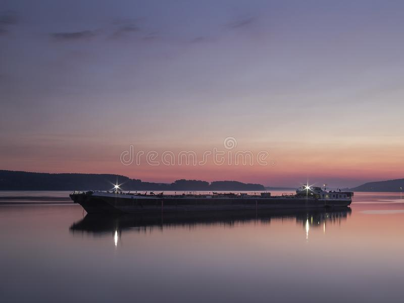 A ship on the Danube river at dawn royalty free stock photo