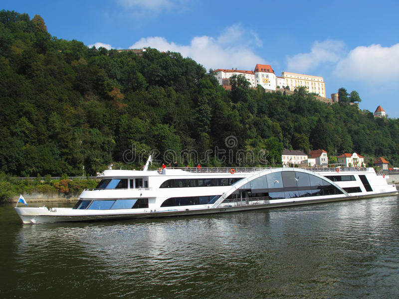 Ship on Danube river under the old Castle stock photo