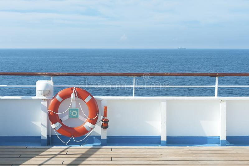 Ship deck. Buoy and blue ocean. Travel background royalty free stock image