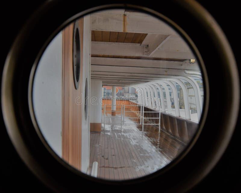 Ship deck view through round window. stock photo