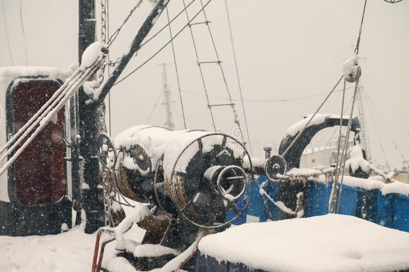 Ship deck. View of the ship deck covered by snow stock photo