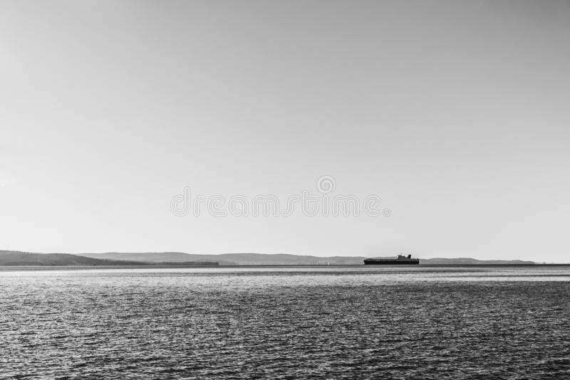 Ship is delivering cargo on a clear day royalty free stock photography