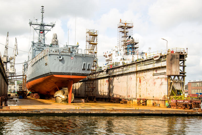 The ship at the dock. Warship standing at home during the renovation of the class in Gdynia Shipyard stock image