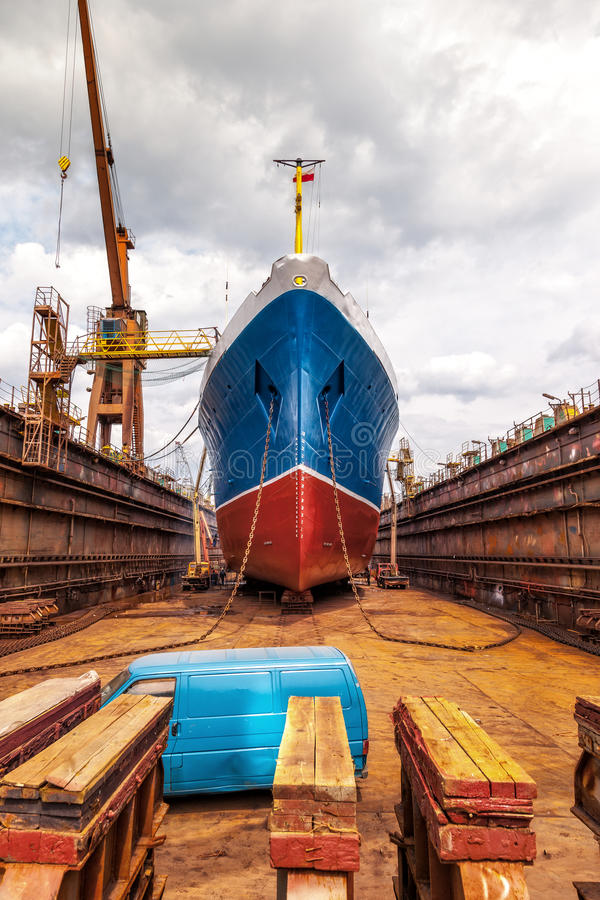 Ship in dry dock. Big ship at dry dock with its bulbous parts and anchor chain stock photo