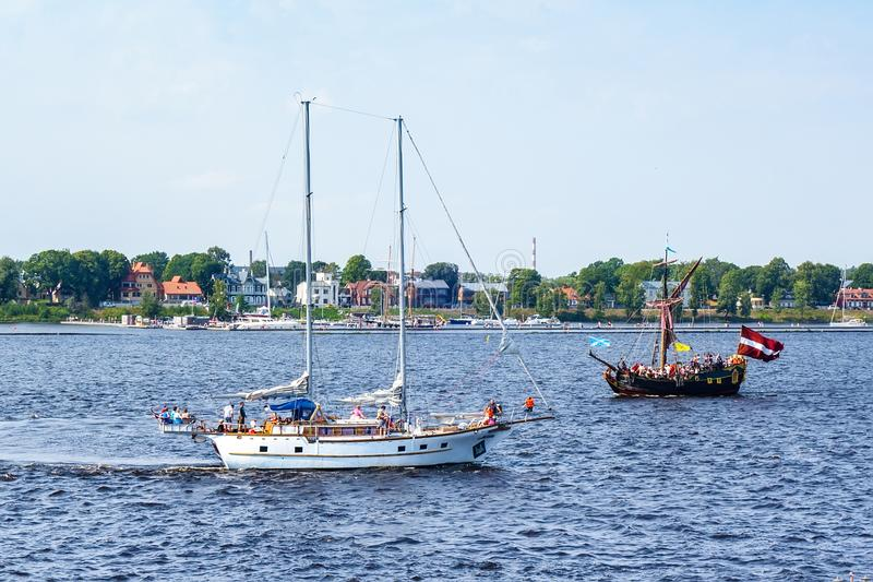 Ship floats the river Daugava stock photos