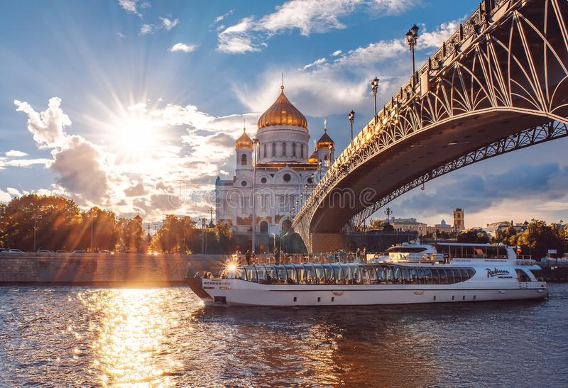 Ship of Flotilla Radisson Royal. Moscow River Cruise. The Cathedral of Christ the Savior at sunset. Russia, Moscow royalty free stock image