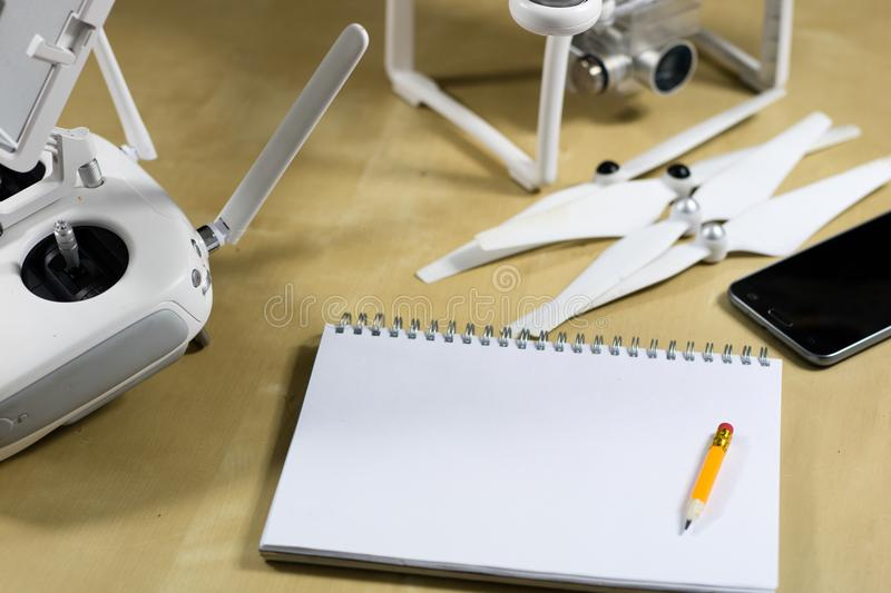 Ship flying and accessories on a wooden table. Drone notebook an stock image
