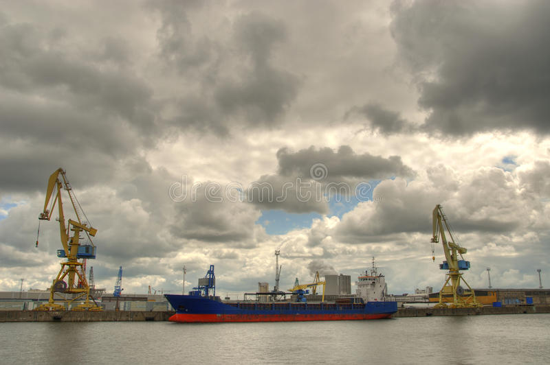 Ship in habor. Harbor. Ship being unloading in Rostock, Germany stock photo