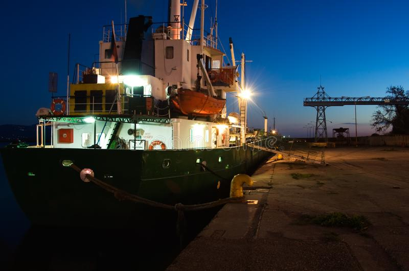 Ship at harbor at dusk royalty free stock photo