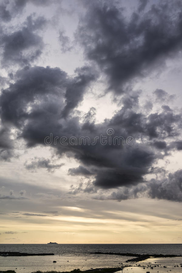Ship on the horizon with clouds royalty free stock photography