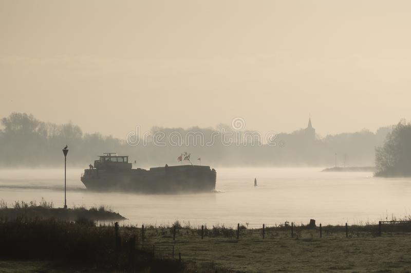 Ship on the IJssel river near Wilsum, Netherlands royalty free stock image