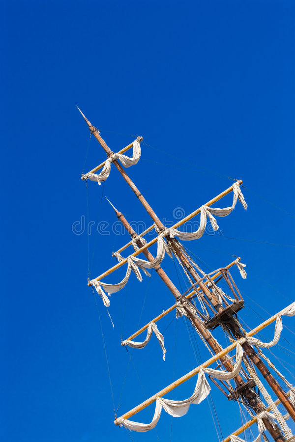 Ship mast. An old ship mast with the sails closed stock photography