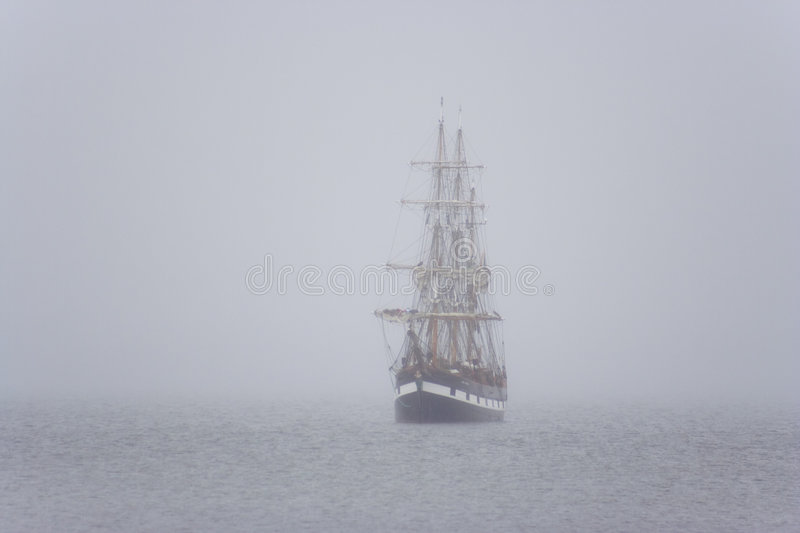 Ship in the mist stock images