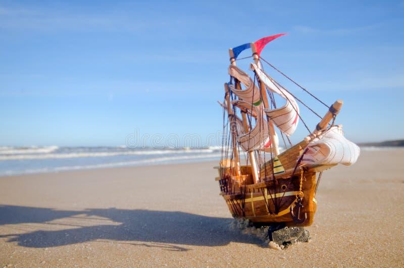 Ship model on summer sunny beach stock photos