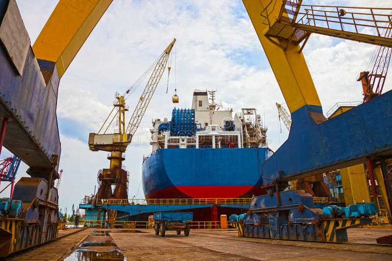 Shipyard Scenery. Ship and monumental crane in the shipyard royalty free stock photography