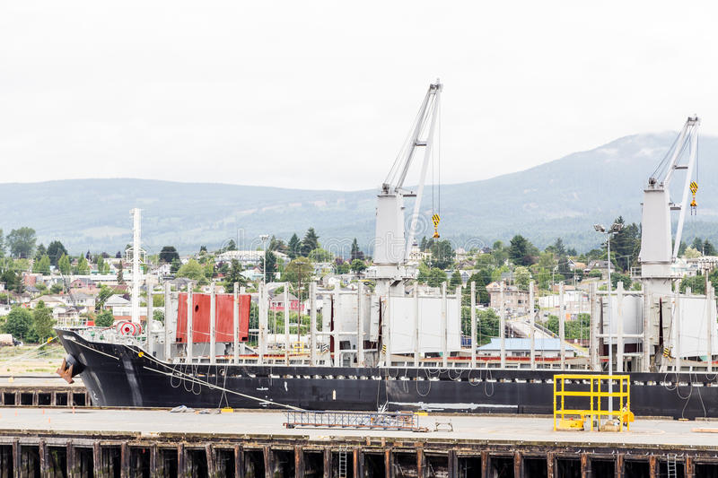 Ship in Nanaimo Dry Dock. Heavy industry at a ship yard in Nanaimo stock photography