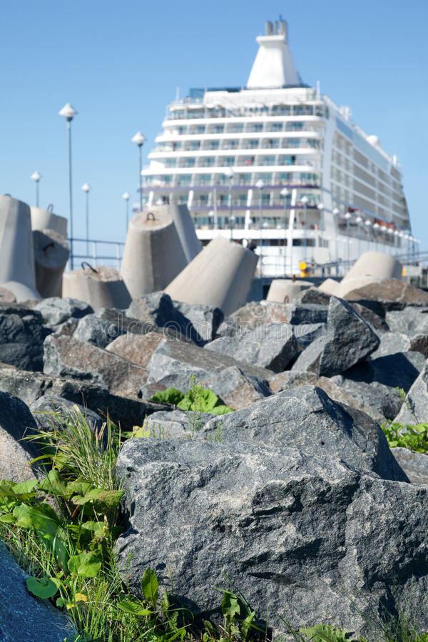 Ship Near  Stones Grass Concrete Blocks Royalty Free Stock Photography