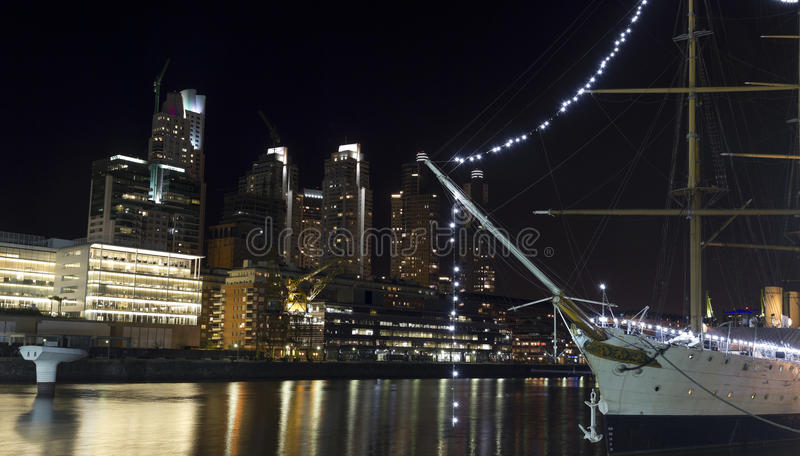 Ship by night in Buenos Aires. Dusk in Puerto Madero neighborghood or disctrict in Buenos Aires city, Argentina royalty free stock images
