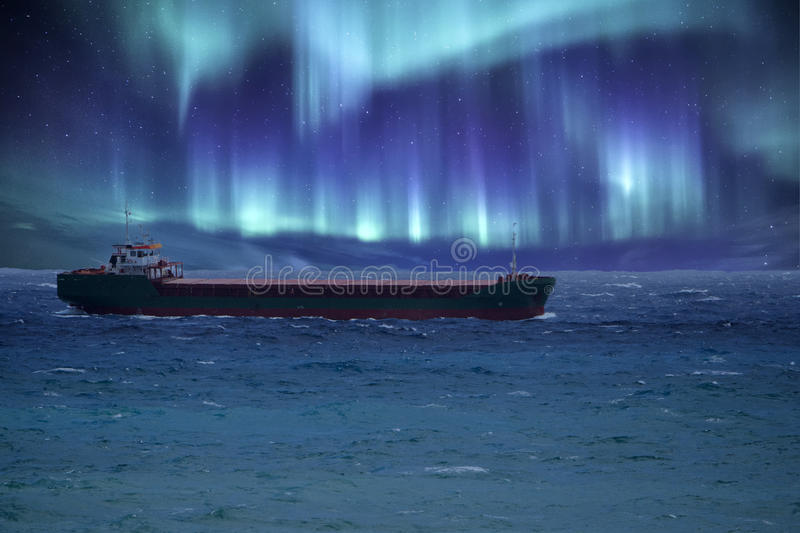 Ship in northern lights background royalty free stock photos