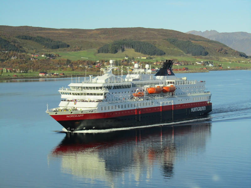 Ship norwegian hurtigruten cruising fjord. Ship of hurtigruten cruising norwegian fjord stock photography
