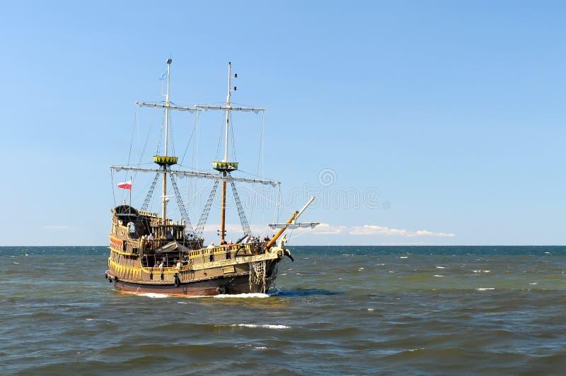 Ship on open seas. Ship sailing open seas on sunny day stock image