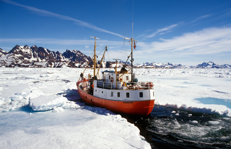 Ship In Pack Ice In Greenland Stock Photo