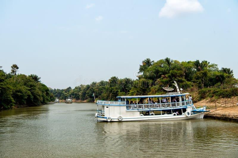 Ship with passengers at river bank stock photos