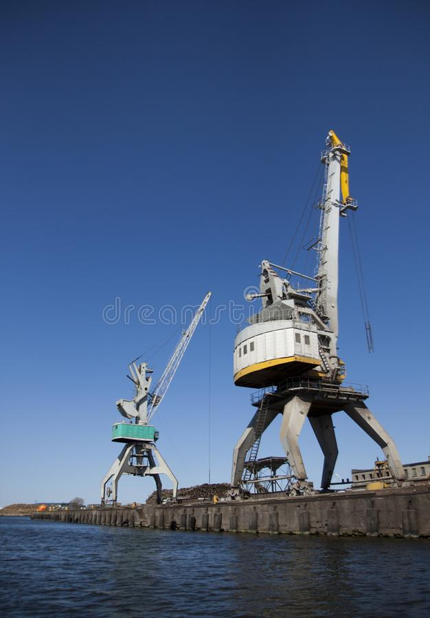 Ship port with drive cranes. High lift trucks at the port`s port royalty free stock photography