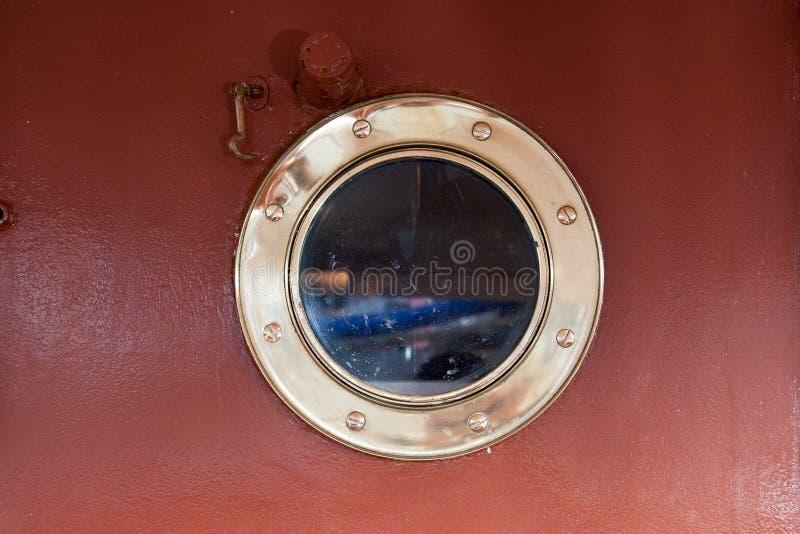 Ship porthole royalty free stock photo