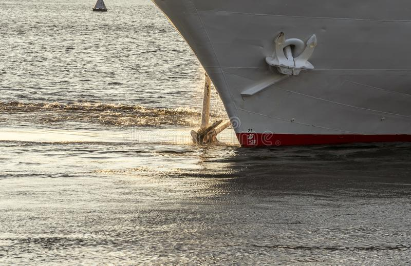 The ship raises the anchor of the water close-up.  stock photos