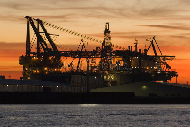 Ship repair. Silhouette of dock- and shipbuilding company at sunset stock photos