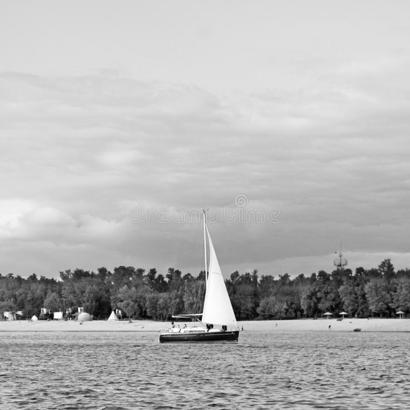 Ship on the river. Black and white photo.  stock images