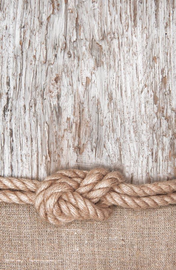 Ship rope, burlap and wood background stock photo