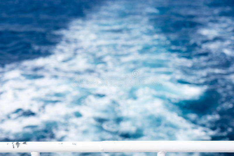 Ship`s wake from the yacht. Focus on handrail stock images