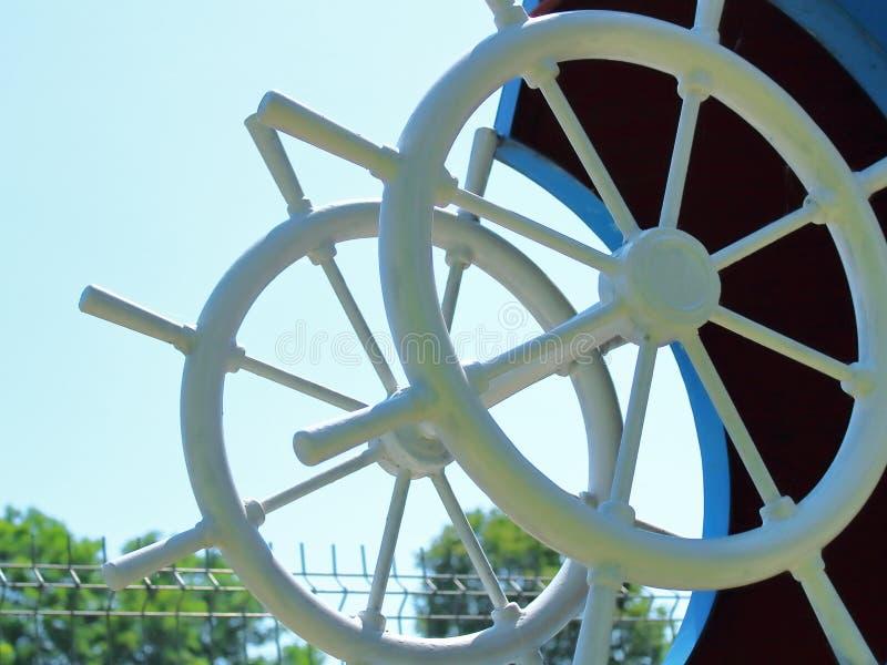 Ship`s wheel illustration on sky royalty free stock image