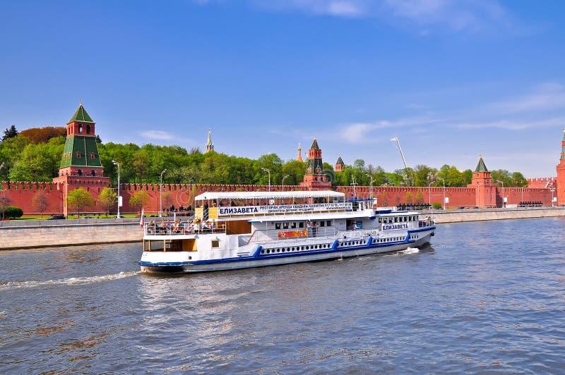 Ship, sailing the background of the Kremlin. stock image